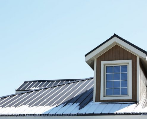 elastomeric roof coating on metal roof in canada