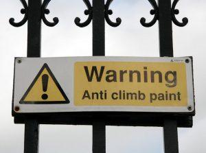 anti-climb-paint warning