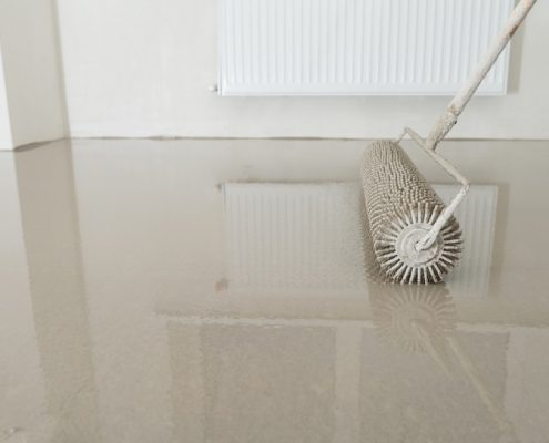 applying floor coating with a roller