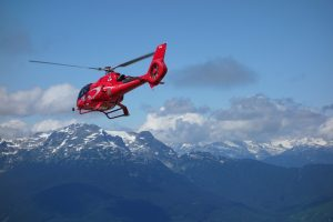 Aerospace coating on a helicopter over Canadian mountains