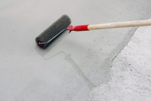 Concrete paint applied as a concrete floor coating with a roller