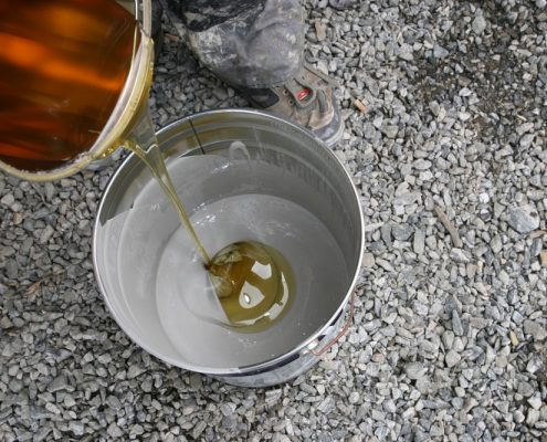 Mixing two component epoxy coating in a paint tin