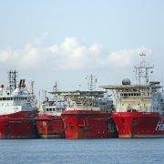 Ships coated with paint containing coating resins